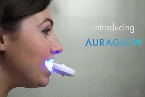 Woman With AuraGlow Led Light In Mouth
